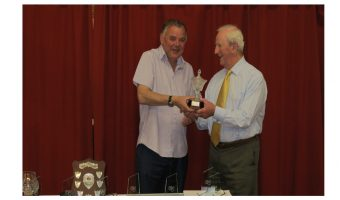 Ian receiving his trophy from David