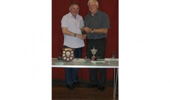 John receiving his trophy from David